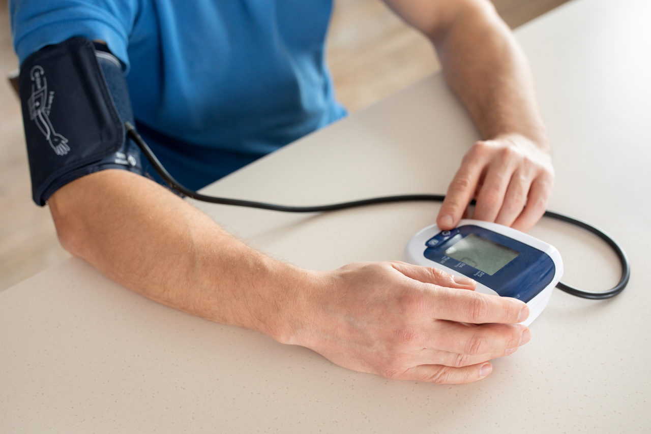 Hypertension Concept. Man Is Measuring Blood Pressure With Monit